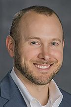 Dr. Daniel Smith, director of the Political Economy Research Institute; associate professor in Economics and Finance