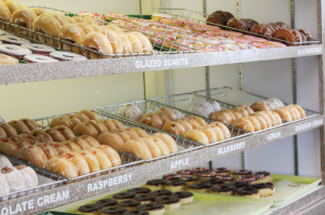 Donuts lined up at counter of Donut Country