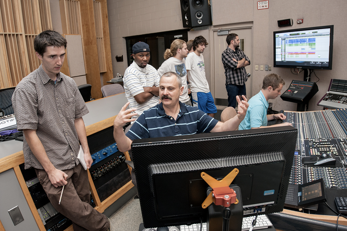"MTSU recording industry professor John Hill, seated center, works with then-students William F. Hunt, left, Cory Todd, Michael Tracy, Daniel Drake, Brian Sanders (partially obscured), Benton Cummings and Michael Kundert in Studio A in the Bragg Media and Entertainment Building in this 2011 file photo. Hill won the 2010 Grammy for best classical engineered album with colleagues Mark Donohue and Dirk Sobotka for their recording of ""Daugherty: Metropolis Symphony; Deus Ex Machina,"" composed by Michael Daugherty and performed by the Nashville Symphony Orchestra. The professor's one of eight MTSU winners of a total of 19 Grammys, including four repeat recipients, since 2001. (MTSU file photo)"