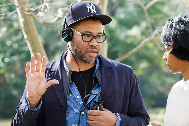 "Oscar-winning writer/director and comic Jordan Peele talks with actor Betty Gabriel during filming of his debut project, ""Get Out,"" in Alabama in 2016 in this file photo from Universal Studios. Peele's second project, ""Us,"" opens Friday, March 22, nationwide. (Photo courtesy of Justin Lubin/Universal Pictures/Everett Collection)"