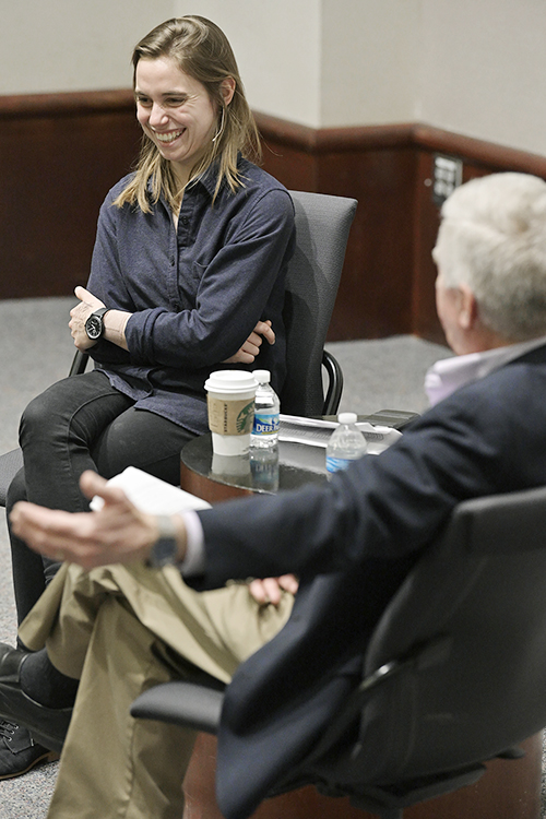 "Acclaimed singer-songwriter Julien Baker, left, a former MTSU student, laughs during a conversation with her former adviser, English professor Jimmie Cain, March 19 during Baker's return visit to campus as part of the College of Media and Entertainment's Tom T. Hall Writers Series. Baker, who majored in English and minored in secondary education and Spanish with an eye toward teaching, began writing songs her freshman year at MTSU, and those songs ultimately became her debut studio album, ""Sprained Ankle,"" in 2015. The collection wound up on multiple critics' best-of lists, launching what would quickly become an international career in indie rock. (MTSU photo by Andy Heidt)"