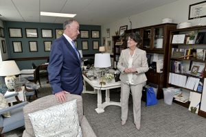 """MTSU Board of Trustees Chairman Steve Smith, left, talks to State Rep. Susan Lynn about growth and progress the university is making March 12 during the MTSU Day on the Hill in the Cordell Hull Building at the capitol in Nashville, Tenn. Lynn, who represents Wilson County, shared about """"having a soft spot"""" for MTSU because her son Michael Lynn graduated from and daughter Grace Douchette attended the Murfreesboro university (MTSU photo by Andy Heidt)"""