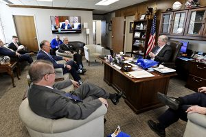 Tennessee Lt. Gov. Randy McNally, right, laughs while carrying on a conversation with MTSU's Joe Bales, foreground left, vice president of University Advance, and Board of Trustees Chairman Steve Smith March 12 during MTSU Day on the Hill. MTSU officials shared updated information with state legislators during the visit. (MTSU photo by Andy Heidt)