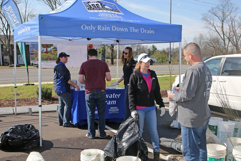 In this 2017 file photo, MTSU Stormwater Program staff chat with area residents participating in the mid-March tree giveaway in partnership with the city of Murfreesboro. (Photo courtesy of Ron Crabtree)