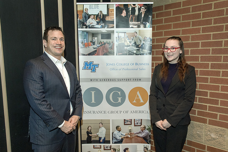 Jamie Noe, left, owner and founder of Insurance Group of America, is pictured with MTSU junior Christine Owens, the first student in the Professional Sales Concentration, at the February MTSU Professional Sales Program Advisory Board meeting at Jonathan's Grille in Murfreesboro. Noe was honored for IGA's five-year, $100,000 contribution to the program. (MTSU photo by Andy Heidt)