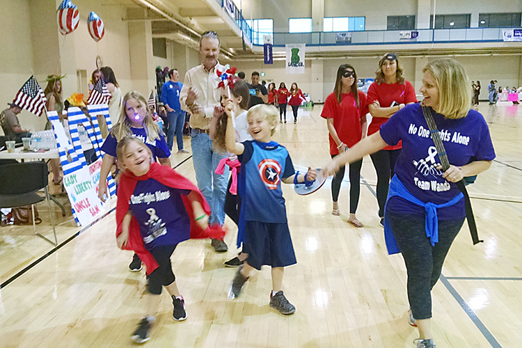 Walkers participate in the 2018 MTSU Relay for Life fundraising event at the Campus Recreation Center. The 2019 event is set Friday, March 22. (Photo courtesy of Relay for Life)