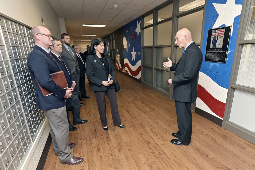 THEC Executive Director Mike Krause, front left, and Tennessee Department of Veterans Services Deputy Commissioner Tilman Goins and Commissioner Courtney Rogers listen as MTSU's Keith M. Huber, right, provides details about the combined 3,200 square feet of dedicated office space for student veterans in the Charlie and Hazel Daniels Veterans and Military Family Center during a scheduled visit Tuesday (March 26).