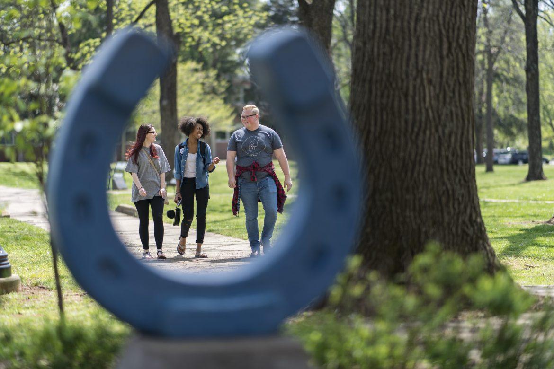 Campus Shots of students at Library, Horseshoe and Kirksy Old Main