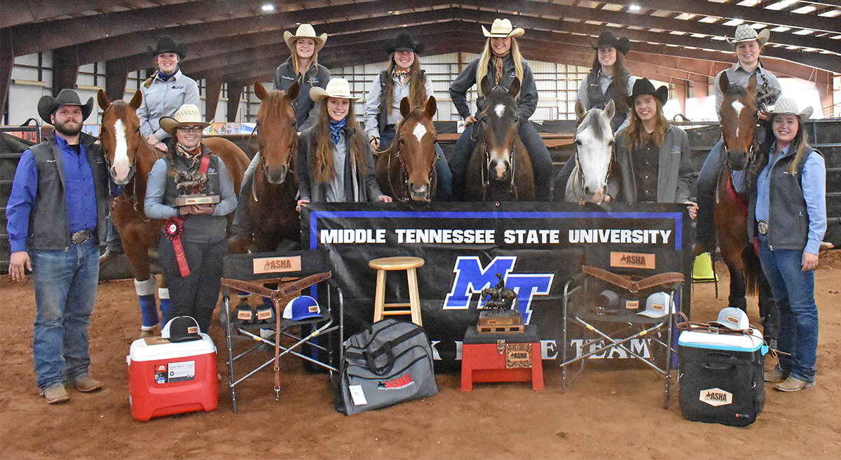 Nine MTSU riders helped capture the American Stock Horse Association Collegiate and National Show Division II championship earlier in April. Team members include, from left, graduate assistant Lucas Brock, Caroline Blackstone, Jenna Seal, Patricia Wingate, Taylor Meek, Kylie Small, Jennifer Dowd, Mary Wade, Lindsay Gilleland, Hunter Huddleston and coach Andrea Rego. Seal and Huddleston hold first-place awards; the national champion trophy is in front of the MTSU stock horse sign.