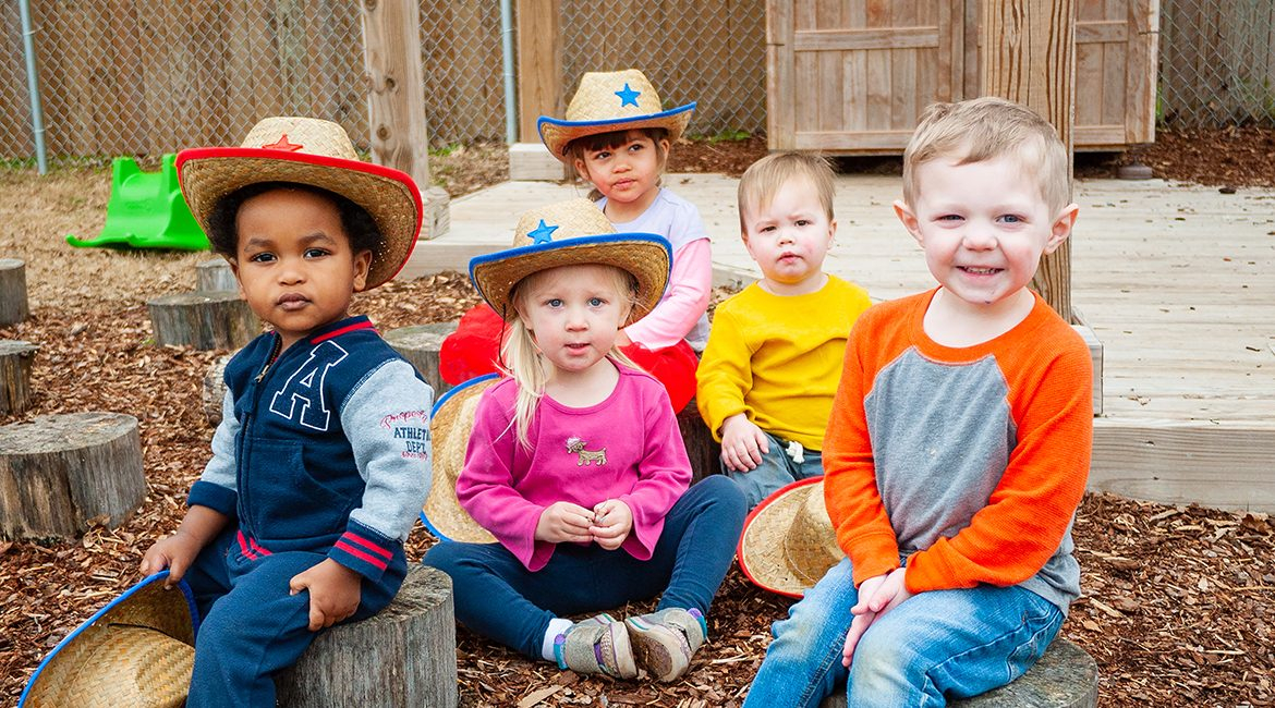 These little cowhands are taking a break on their unique wheelchair-accessible natural playground at MTSU's Ann Campbell Early Learning Center before they join the fun Saturday, April 20, at the Tennessee Livestock Center at the annual