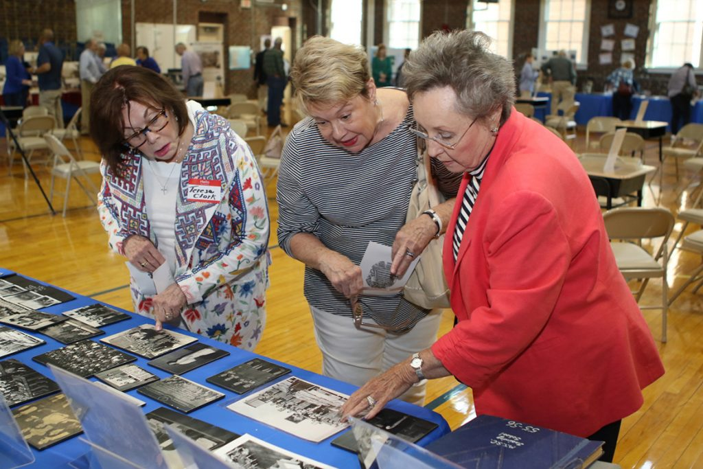 Teresa J. Clark-Owens, left, Marylou Turpin and Linda Dansby look at historical photos related to the Homer Pittard Campus School during its 90th anniversary celebration Tuesday, April 16, at the school's East Lytle Street campus. The teaching laboratory school is owned by MTSU and operated by Rutherford County Schools. (MTSU photo by James Cessna)