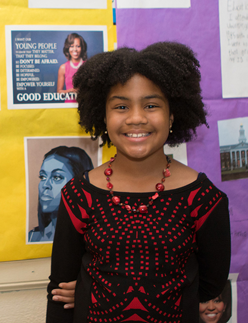 Campus School fifth-grader Jada Scott, portraying former first lady Michelle Obama, stands in front of the display that was part of Homer Pittard Campus School's open house. The teaching laboratory school owned by MTSU and operated by Rutherford County Schools held its 90th anniversary celebration Tuesday, April 16, at the school's East Lytle Street campus. (MTSU photo by James Cessna)