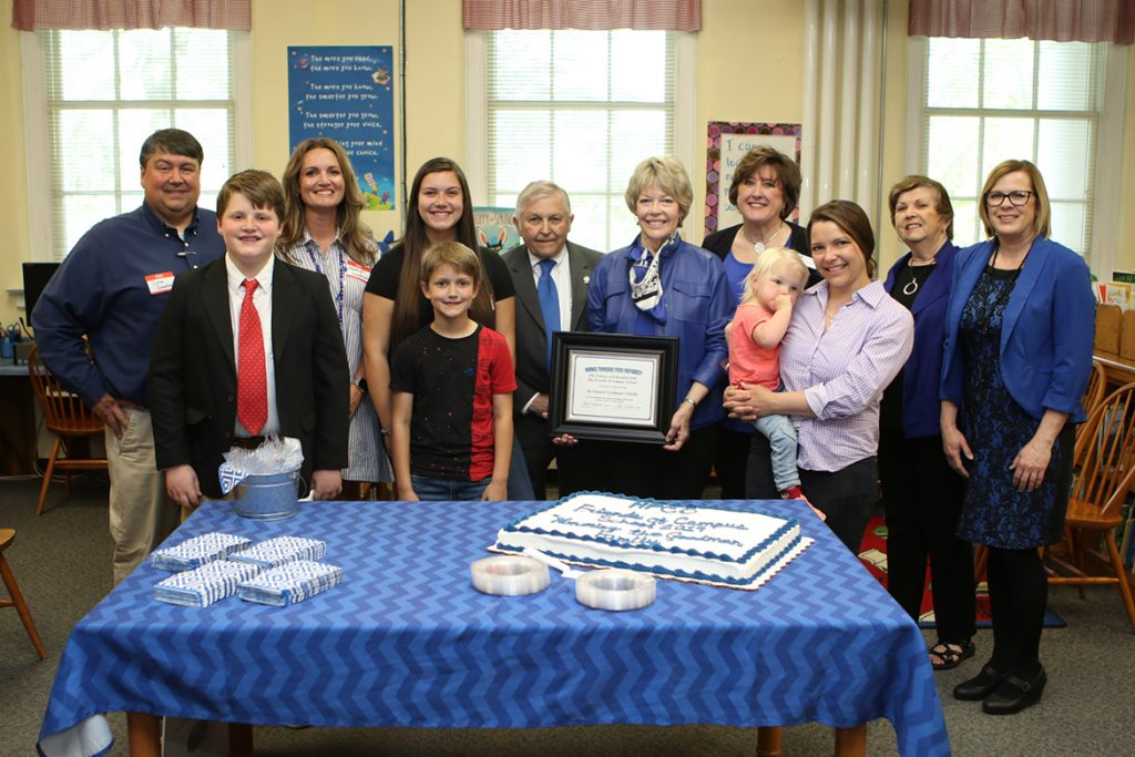 The Friends of Campus School honored the Charles Goodman family for its longstanding connections to the school during the Tuesday, April 16, open house and 90th anniversary celebration at the Lytle Street campus. Pictured, from left, are John Goodman, Jack Goodman, Heather Goodman, Annabelle Goodman, Knox Goodman, Charles Goodman, Delia Goodman, MTSU Education Dean Lana Seivers, Carolyn Goodman-Henn, Marcie (being held), Friends of Campus School President Rita Schaerer-King and school Principal Sherry King. (MTSU photo by James Cessna)