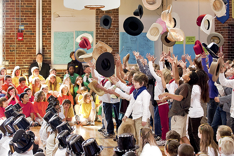"Third-grade students at Homer Pittard Campus School toss their hats in the air while performing ""I'm an Old Cowhand"" in the gymnasium at the school's 80th anniversary celebration in this 2009 file photo. Campus School is celebrating 2019 as its 90th year of service to elementary school students — and to Middle Tennessee State University education majors who did their student teaching there — with a big April 16 event. (MTSU file photo by J. Intintoli)"