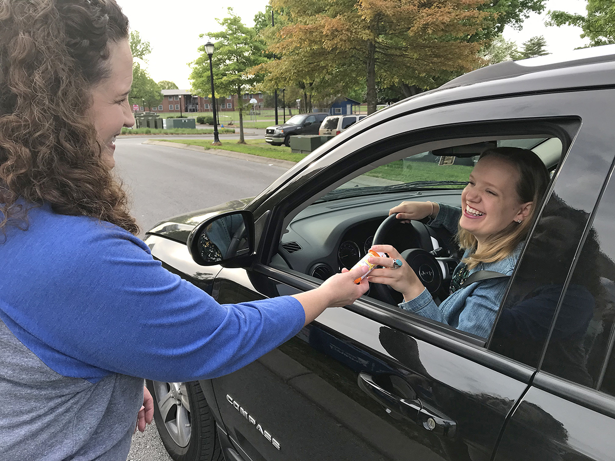 MTSU Campus Pharmacy pharmacist Tabby Ragland, left, accepts a bottle of unwanted prescription medication from Olivia Beaudry, an archivist for the MTSU Center for Popular Music, during the in October 2018 MTSU Prescription Drug Take-Back Day at the pharmacy drive-thru outside the Student Health, Wellness and Recreation Center. This year's drug take-back day will be from 7:30 a.m. to 1 p.m. Thursday, Oct. 24. (MTSU file photo by Randy Weiler)
