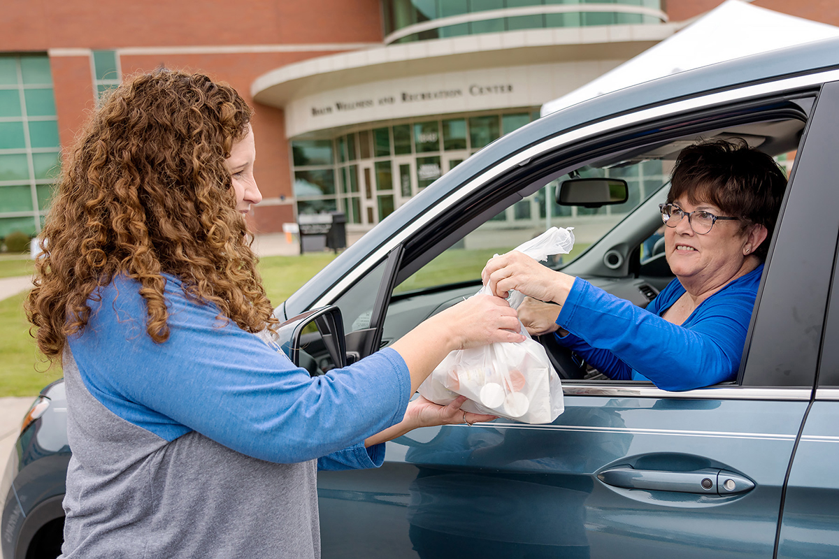 MTSU pharmacist Tabby Ragland, left, takes a bag of unwanted medications from Carolyn Powers, MTSU retiree, in October 2018 during the Campus Pharmacy/University Police drug take-back event at the Campus Rec Center. This event is part of the Drug Enforcement Agency's overall efforts to remove excess drugs from communities where they could be abused or misused, diverted into the wrong hands or disposed of in environmentally unsafe ways.