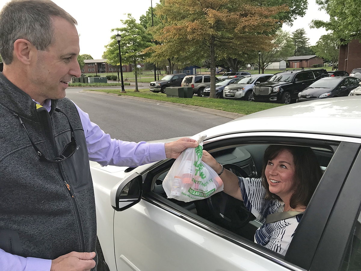 Greg Young, left, associate dean with Lipscomb University's College of Pharmacy, accepts a bag of unwanted medications from Kristin Wells, MTSU development director for the College of Behavioral and Health Sciences, Tuesday, April 23, near the Campus Pharmacy drive-thru outside the Student Health, Wellness and Recreation Center. MTSU and Lipscomb partner to collect and document the medicines two times a year during the MTSU Prescription Drug Take-Back Day.