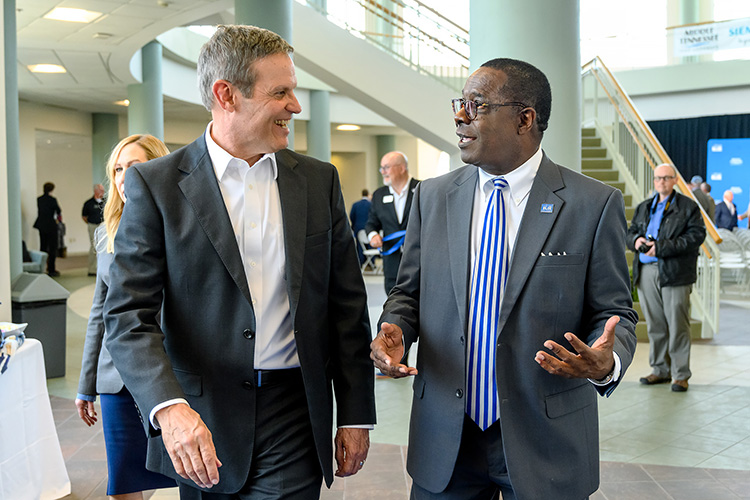 Tennessee Gov. Bill Lee, left, chats with MTSU President Sidney A. McPhee Wednesday, April 3, at the Miller Education Center on Bell Street. Lee visited campus to tout the ready-to-work programs offered at MTSU such as mechatronics engineering, as well as recognize the in-kind software grant from Siemens Digital Industries Software that provides hands-on training for MTSU mechatronics students. (MTSU photo by J. Intintoli)