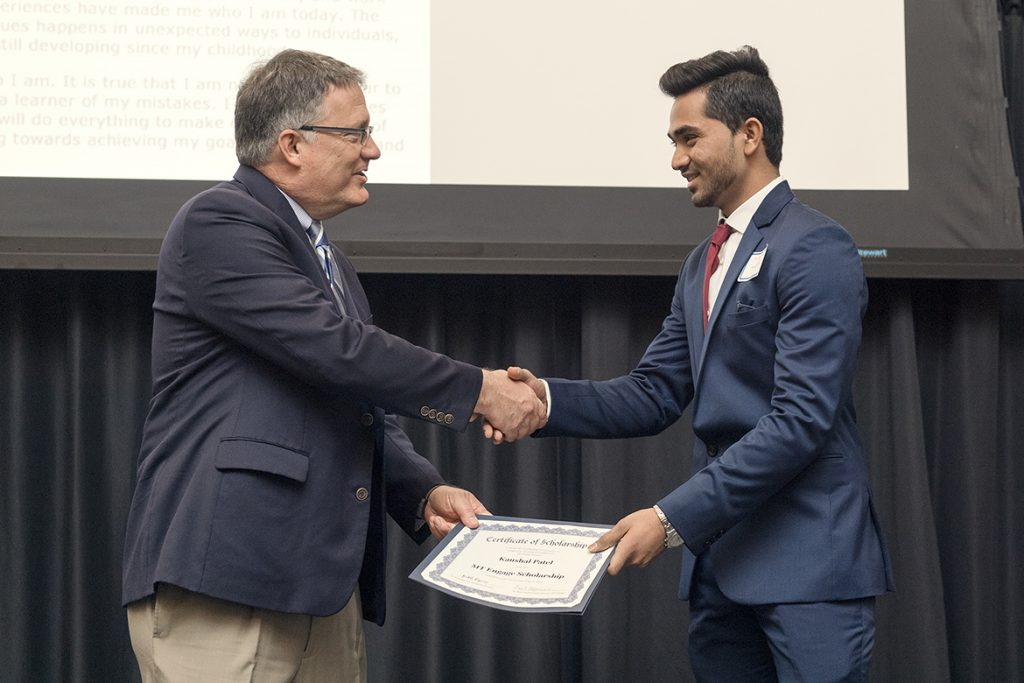 University Provost Mark Byrnes, left, congratulates Jones College of Business student Kaushal Patel for winning a scholarship during the 2019 Spring MT Engage Reception held April 4 in the Student Union Ballroom. (MTSU photo by Andy Heidt)