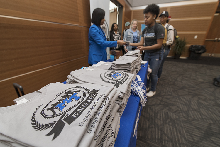 Students sign in before receiving free T-shirts April during the 2019 Spring MT Engage Reception in the Student Union Ballroom. (MTSU photo by Andy Heidt)