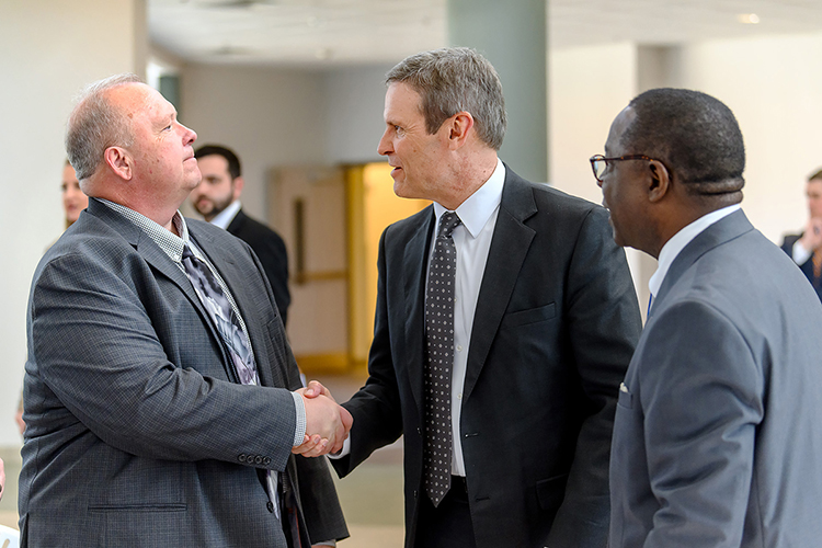 MTSU College of Basic and Applied Sciences Dean Bud Fischer, left, shakes hands with Tennessee Gov. Bill Lee as they meet for the first time while MTSU President Sidney A. McPhee watches. The exchange occurred Wednesday (April 3) at the Miller Education Center as MTSU recognized the Siemens company for its generous grant of computer-aided design software for the mechatronics engineering program. (MTSU photo by J. Intintoli)