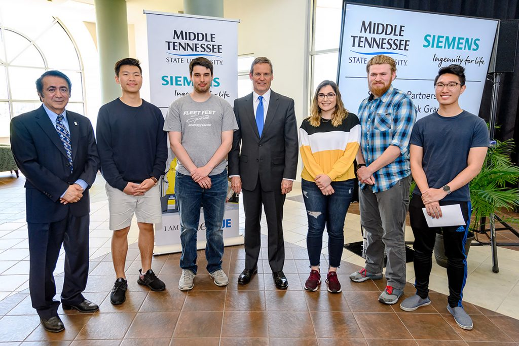 Tennessee Gov. Bill Lee poses for a photo with MTSU mechatronics engineering students Wednesday (April 3) in the Miller Education Center following the university event recognizing Siemens company's generous grant of computer-aided design software to the program. From left are Saeed Foroudastan, faculty adviser and associate dean for the College of Basic and Applied Sciences, Kevin Pan, Edward Thomason, Lee, Sarah Zakaria, Noah Bright and Brandon Soundara. (MTSU photo by J. Intintoli)