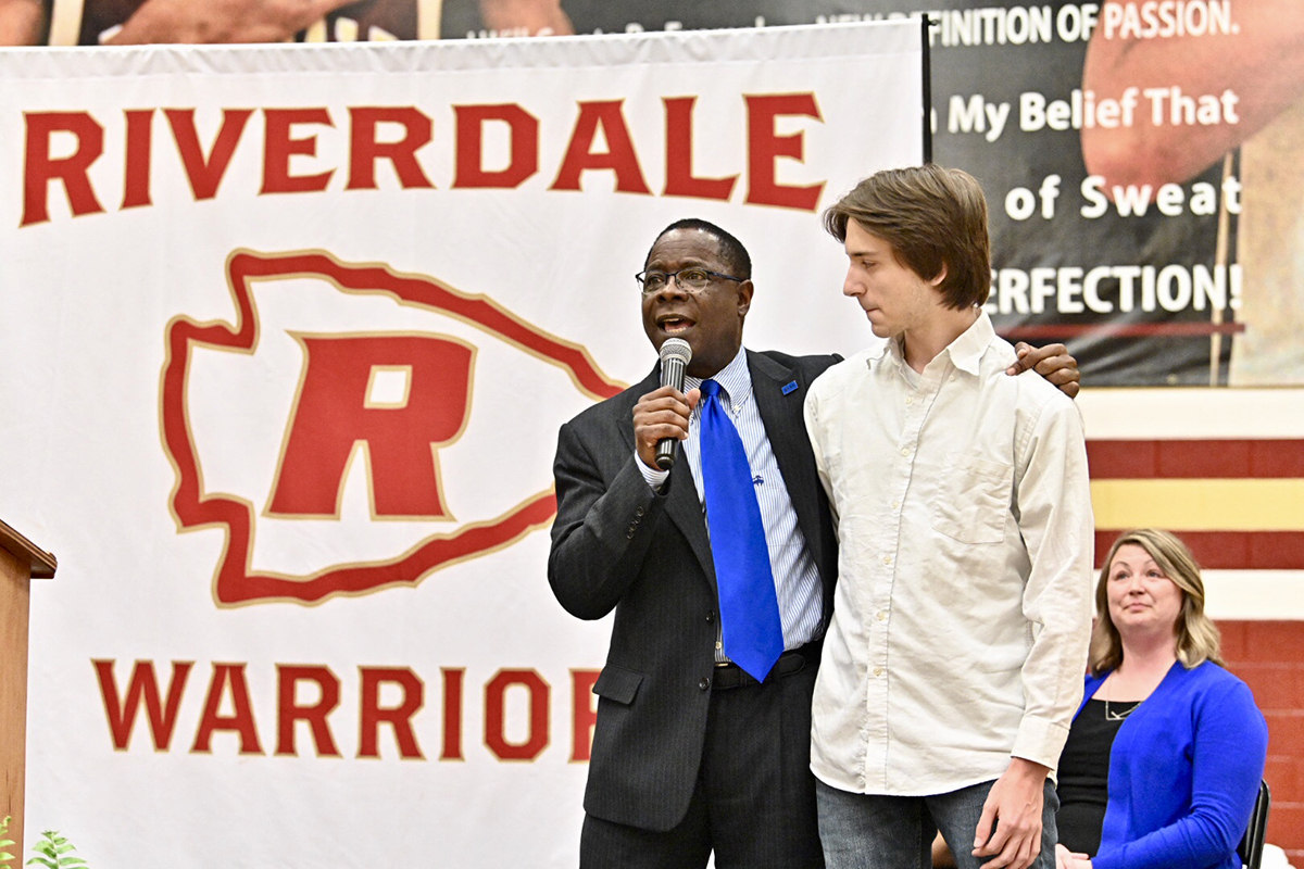 MTSU President Sidney A. McPhee, left, talks with Riverdale High School senior Trevor Ewing after the student's name was drawn to receive a $2,500 scholarship from the university Friday (April 5) during the first College and Career Signing Day at the school.