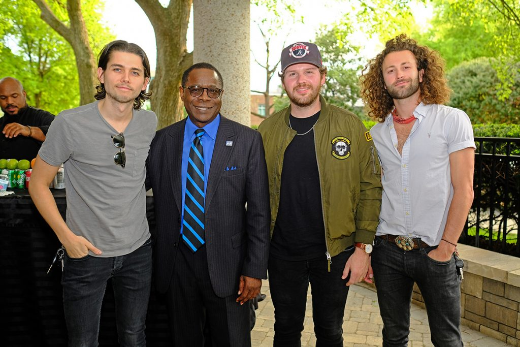 MTSU President Sidney A. McPhee, second from left, poses with university alumni Chandler Baldwin, left, Jared Hampton and Eric Steedly, who are members of the award-winning country music group Lanco. McPhee, on behalf of the university, presented the trio with certificates for their accomplishments and excellence in artistic expression on Wednesday, April 17, at BMI in Nashville, Tenn. (MTSU photo by David Foster)
