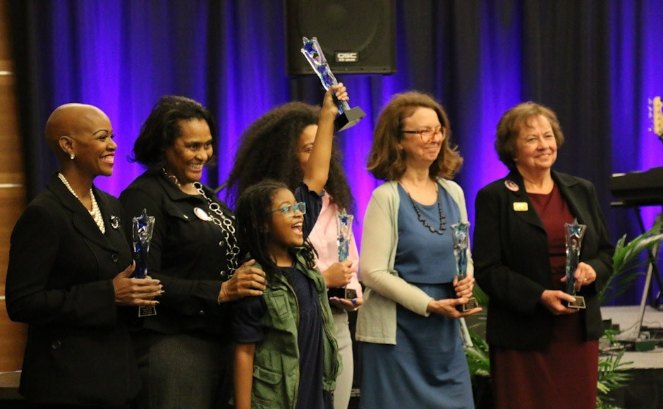 """Lynda Williams, left, celebrates with her fellow """"Trailblazers"""" honorees during MTSU's 2019 National Women's History Month kickoff ceremony March 12 in the Student Union Ballroom."""