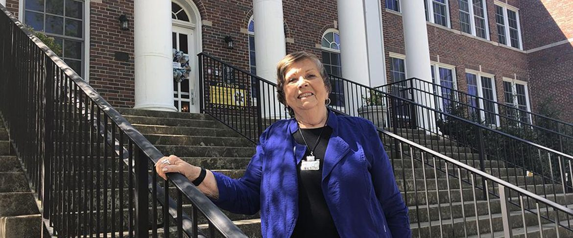 Dr. Rita King, former principal and current president of the school's support group, Friends of Campus School, stands in front the school on East Lytle Street. (Photo courtesy of James Evans, Rutherford County Schools)