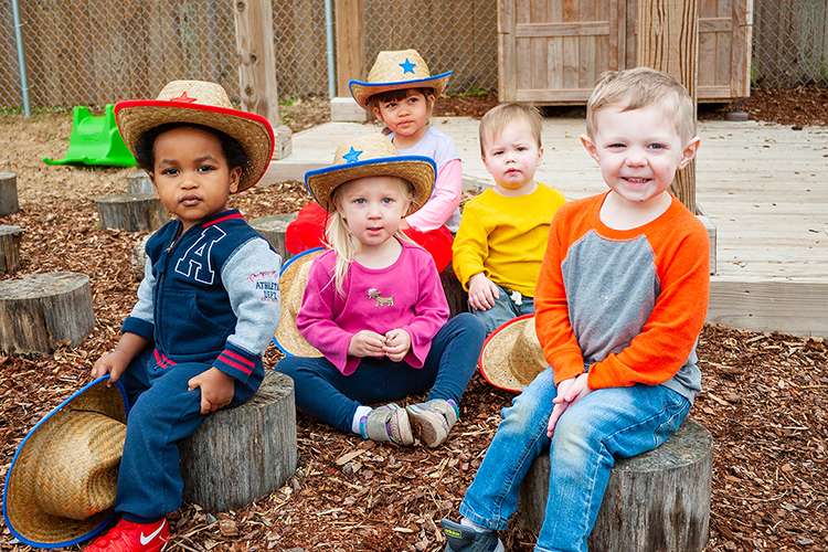 "These little cowhands are taking a break on their unique wheelchair-accessible natural playground at MTSU's Ann Campbell Early Learning Center before they join the fun Saturday, April 20, at the Tennessee Livestock Center at the annual ""Saddle Up"" party and fundraiser. The 8:30-11:30 a.m. schedule will feature animals from the Discovery Center at Murfree Center, face painting, bowling, a corn sensory bin, the Department of Engineering Technology Experimental Vehicles Program's award-winning ""moon buggy"" and Baja vehicle, and sensory activities among its 25-plus opportunities for fun as well as the traditional silent auction. ""Saddle Up"" tickets are $10 per person or a $50 maximum per family, and admission includes a light breakfast supplied by local businesses. For more information, visit http://www.mtsu.edu/acelearningcenter or http://www.mtalumni.com/saddleup, or call 615-898-2458. (MTSU photo by Jacob Smith/Ann Campbell Early Learning Center)"