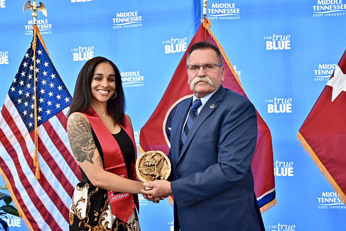 Misty Francis, left, an MTSU graduating veteran, was presented the Journey Award from David Corlew with the Charlie Daniels-led Journey Home Project foundation Wednesday, April 24, at the Miller Education Center. Nearly 50 graduating senior student veterans were given their red stoles to wear during graduation May 3-4.