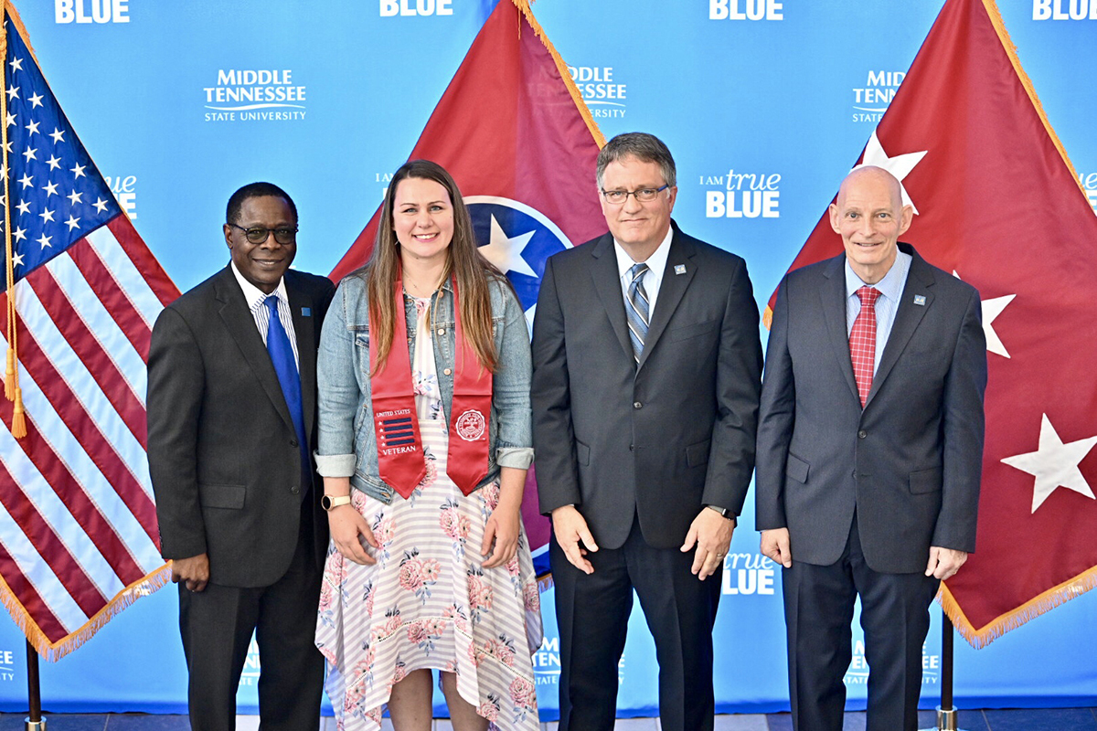 MTSU President Sidney A. McPhee, left, joins graduating veteran Emily Steinway, Provost Mark Byrnes and Keith M. Huber, senior adviser for veterans and leadership initiatives, during the Wednesday, April 24, ceremony at the Miller Education Center. Steinway works full time as the Daniels Center transition manager.