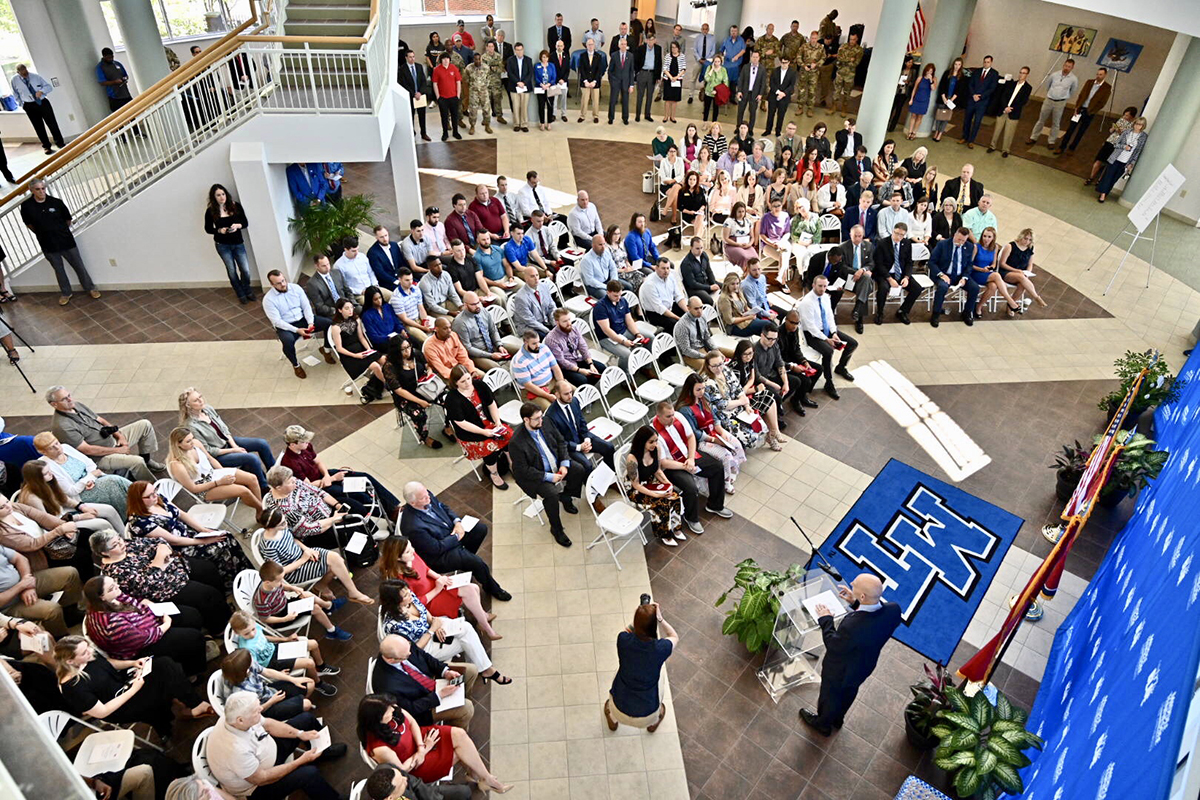 A standing-room-only crowd listens as Keith M. Huber, senior adviser for veterans and leadership initiatives and a retired U.S. Army lieutenant general, shares the importance of recognizing graduating veterans during the special ceremony held before commencement. MTSU's Daniels Veterans Center recognized nearly 50 senior veterans Thursday, April 24, in the Miller Education Center.