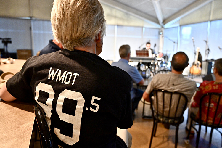 A WMOT Roots Radio 89.5 listener sports a T-shirt of support while she and others listen to indie-folk artist A.J. Croce during his live set at the radio station's 50th anniversary celebration held Tuesday, April 9, at the Cyber Cafe on the MTSU campus. (MTSU photo by J. Intintoli)