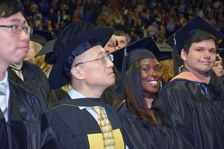 Students ponder their futures and smile for photographers in this file photo from the university's fall 2018 commencement ceremonies in Murphy Center. MTSU will present 2,535 degrees — 394 graduate and 2,141 undergraduate — to spring 2019 graduating students during a two-day commencement event May 3 and 4. (MTSU file photo by GradImages.com)