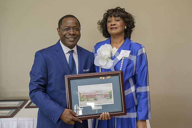MTSU President Sidney A. McPhee, left, presents Cornelia Freeman Cooper, a new 1911 Society member, with a framed rendering of Kirksey Old Main at the seventh annual 1911 Society Luncheon held April 11 at the Stones River Country Club in Murfreesboro. The luncheon honors longtime and estate plan donors to MTSU. (MTSU photo by Andy Heidt)