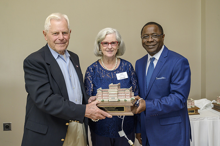 MTSU President Sidney A. McPhee, right, presents David and Frances Singer, Old Main Society members, with a miniature replica of Kirksey Old Main at the seventh annual 1911 Society Luncheon held April 11 at the Stones River Country Club in Murfreesboro. The luncheon honors longtime and estate plan donors to MTSU. (MTSU photo by Andy Heidt)