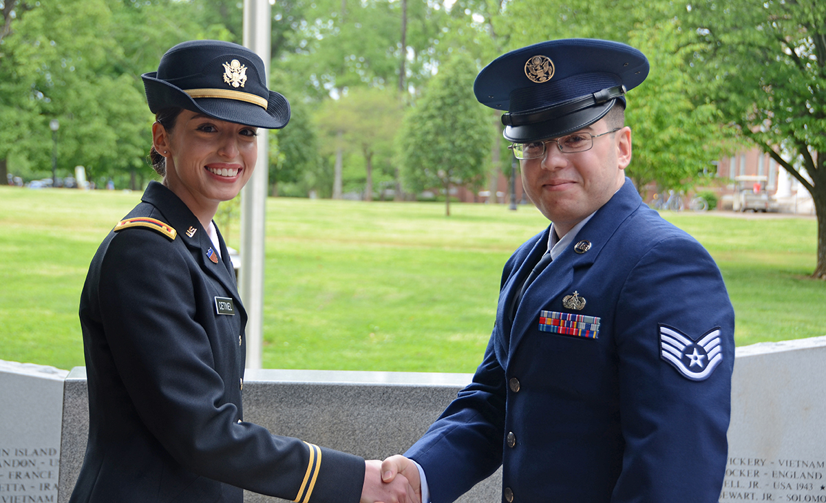 New U.S. Army 2nd Lt. Amber Cetinel, left, of Murfreesboro, and her brother, U.S. Air Force Staff Sgt. Jon Cetinel, make the exchange as part of the Army Silver Dollar Salute Friday, May 3, as part of the military science spring commissioning ceremony at the Veterans Memorial. A journalism major, Amber Cetinel will begin her basic officer leader course in June at Fort Jackson, S.C.