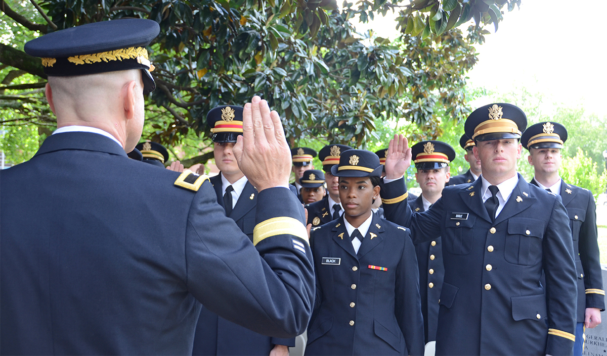 U.S. Army Brig. Gen. Jimmie Cole Jr. administers the commissioning oath to the Army's newest second lieutenants Friday, May 3, at the MTSU Veterans Memorial outside the Tom H. Jackson Building. Nineteen ROTC senior cadets will graduate from MTSU on Saturday, May 4, in Murphy Center. (MTSU photo by Randy Weiler)