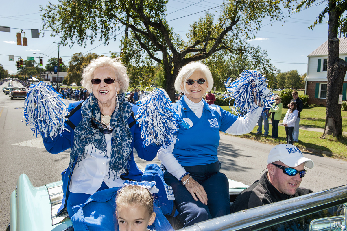 Alumnae Liz Rhea, left, and Hanna Witherspoon sit atop a convertable that's part of the October 2011 MTSU Homecoming Parade traveling down Middle Tennessee Boulevard. Rhea, a 1955 graduate, died Thursday, May 30. (MTSU file photo by J. Intintoli)