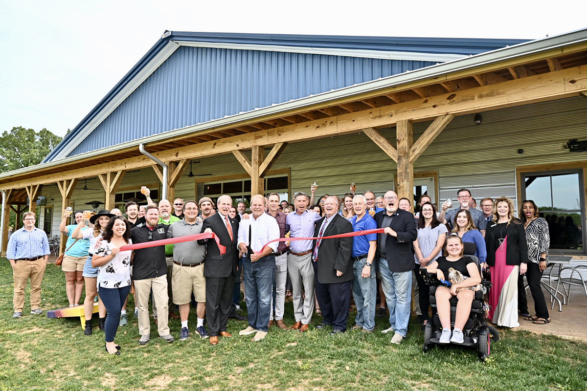 Invited guests, MTSU staff and administrators and Hop Springs owners and personnel participate in the Rutherford County Chamber of Commerce ribbon-cutting Thursday, May 23, to celebrate the grand opening of the facility and partnership with MTSU fermentation science. (MTSU photo by J. Intintoli)