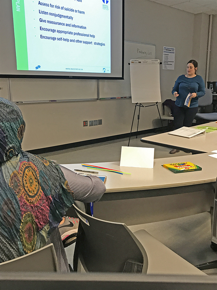 Angela Mueller, Mental Health First Aid project assistant for the MTSU Center for Health and Human Services and a graduate student in the professional counseling program, conducts a certification training workshop earlier this spring on campus. (Submitted photo)