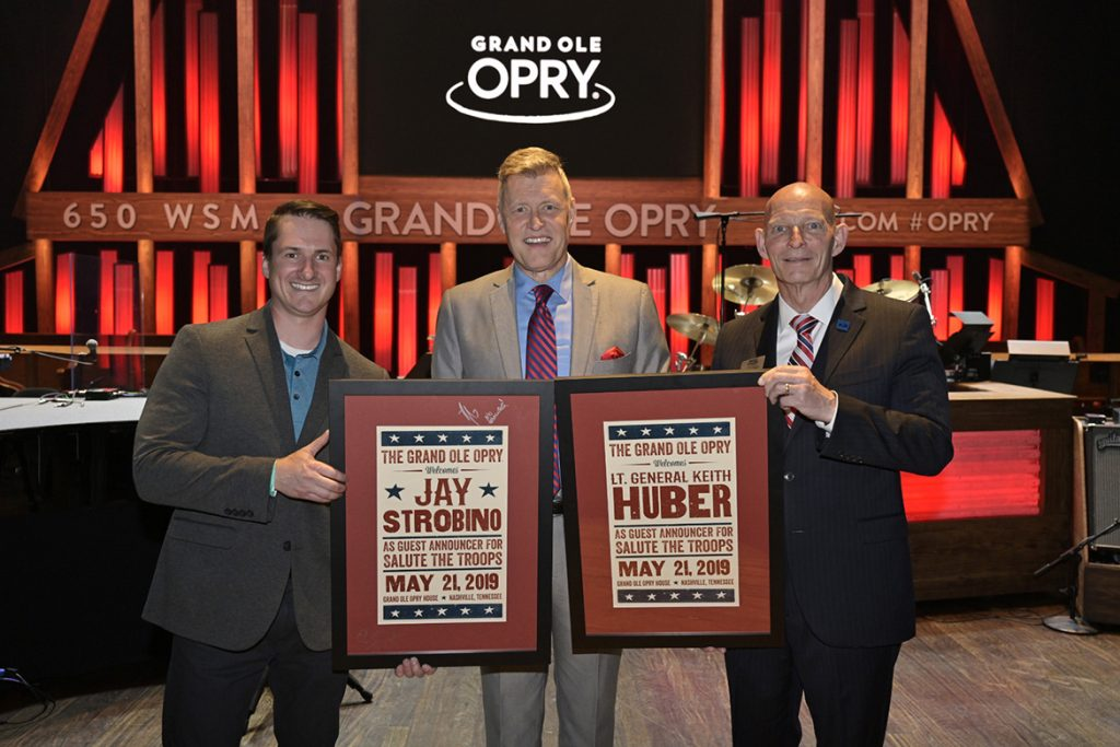 MTSU alumnus and combat veteran Jay Strobino, left, and retired Army Lt. Gen. Keith Huber, the university's senior adviser for veterans and leadership initiatives, right, are congratulated by Grand Ole Opry announcer Bill Cody after the men served as guest announcers for the Opry's Salute The Troops show Tuesday in Nashville, Tenn. (MTSU photo by Andy Heidt)