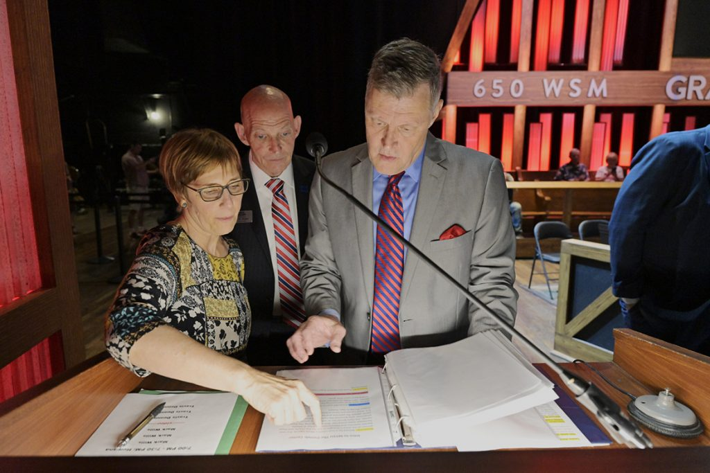 Retired Army Lt. Gen. Keith Huber, MTSU's senior adviser for veterans and leadership initiatives, center, reviews the script for the Grand Ole Opry's Salute The Troops show with Opry announcer Bill Cody, right, and Opry brand partnership manager Elizabeth Price before Tuesday's show in Nashville, Tenn. (MTSU photo by Andy Heidt)