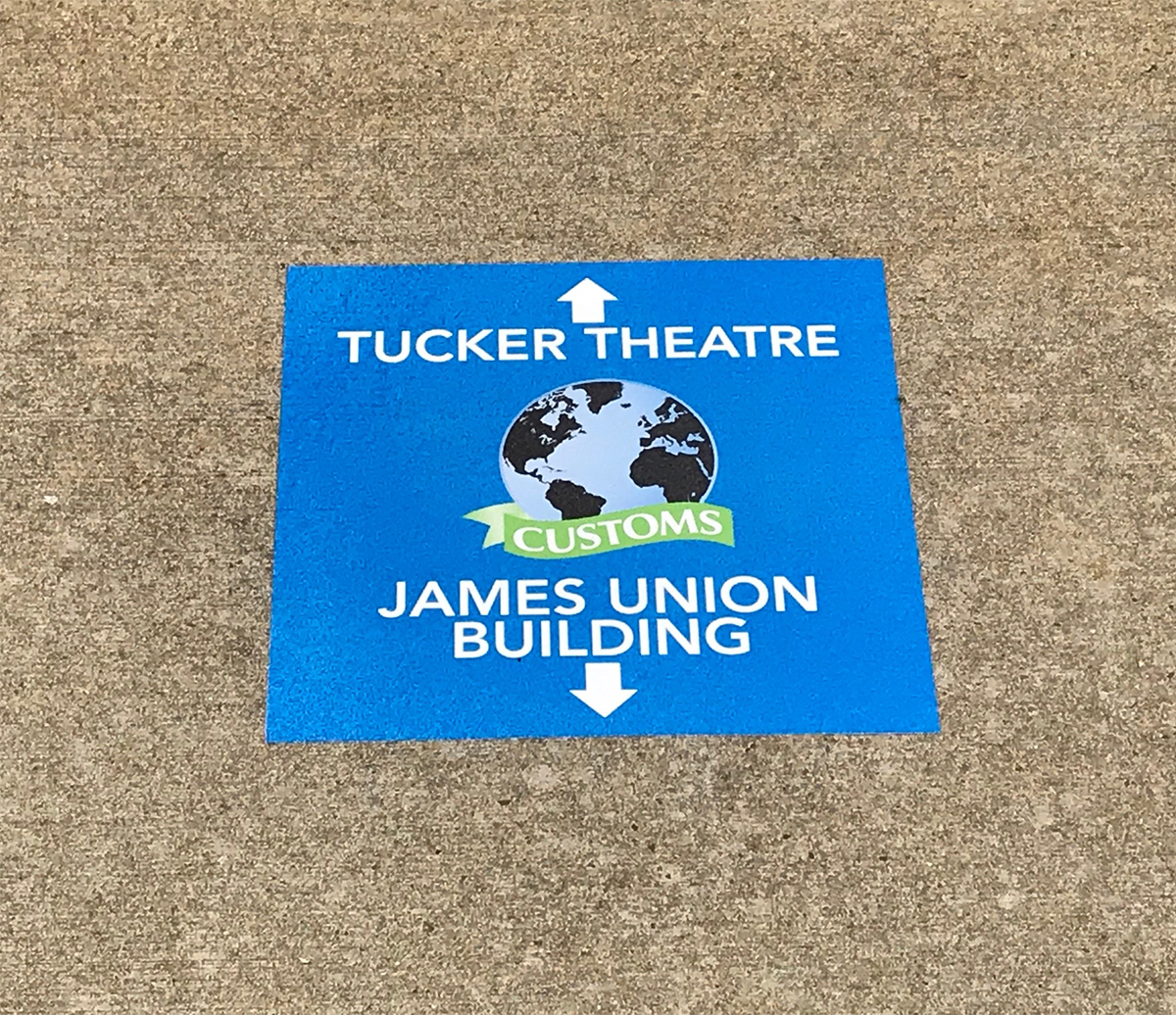 New sidewalk stickers will greet new incoming freshmen and transfer students attending CUSTOMS orientation this spring and summer, and help them find building locations. The first two days of freshman orientation will be Thursday and Friday, May 16-17, and continue for two months. (MTSU photo by News and Media Relations)