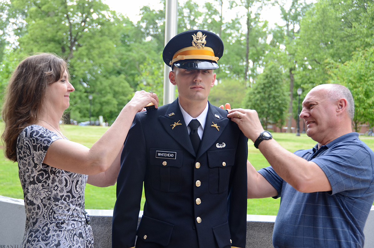 New U.S. Army 2nd Lt. Seth Whitehead, center, of Tullahoma, Tenn., is pinned by his mother and father, Crystal and Michael Whitehead, Friday, May 3, during the MTSU Blue Raider Battalion spring commissioning ceremony at the Veterans Memorial site. The journalism major will begin his basic officer leader course later in May at Fort Benning, Ga.