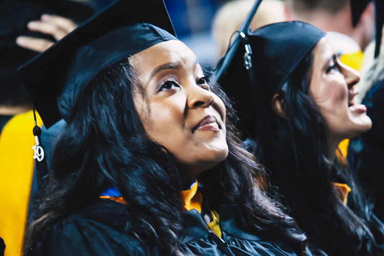 A proud MTSU graduate student looks at and listens to the supportive crowd inside Murphy Center Friday, May 3, during the university's College of Graduate Studies spring 2019 commencement ceremony. MTSU awarded 384 master's and doctoral degrees in the May 3 ceremony and will present 2,145 undergraduates with their diplomas in dual ceremonies Saturday, May 4. (MTSU photo by GradImages)