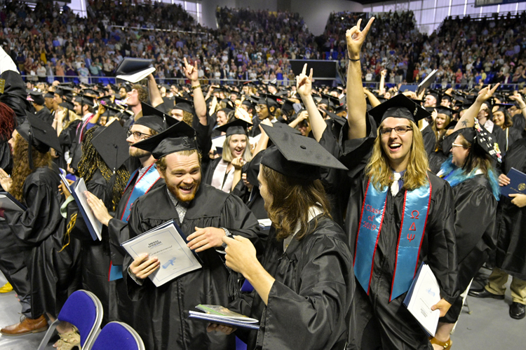 Excited MTSU undergraduate students celebrate receiving their degrees Saturday, May 4, during the university's spring 2019 morning commencement ceremony. MTSU presented 2,145 undergrads with their diplomas in two events Saturday and 384 graduate students with degrees May 3, bringing the university's total new alumni to 2,529. (MTSU photo by Andy Heidt)