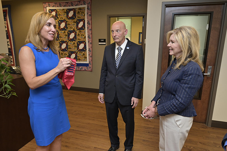 Daniels Veterans Center Director Hilary Miller, left, shows U.S. Sen. Marsha Blackburn one of the red stoles presented to graduating student veterans three times a year in a special ceremony just before commencement. Miller and Keith M. Huber, senior adviser for veterans and military initiatives and a retired U.S. Army lieutenant general, invited the senator to a future stole ceremony. Blackburn visited MTSU Friday, June 21. (MTSU photo by Andy Heidt)